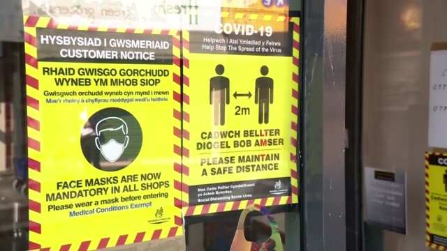 local lockdown starts in rhondda cynon taf wales rhondda cynon taf ext social distancing posters in window - wales stock videos & royalty-free footage
