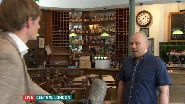 lockdown continues to ease despite warnings of outbreaks england london the warwick pub int artem kravchenko live interview sot - politics stock-videos und b-roll-filmmaterial
