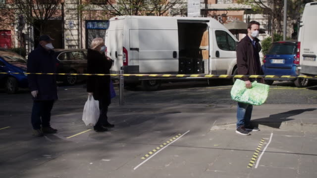 """coronavirus lockdown measures in place at a food market in rome - """"bbc news"""" video stock e b–roll"""