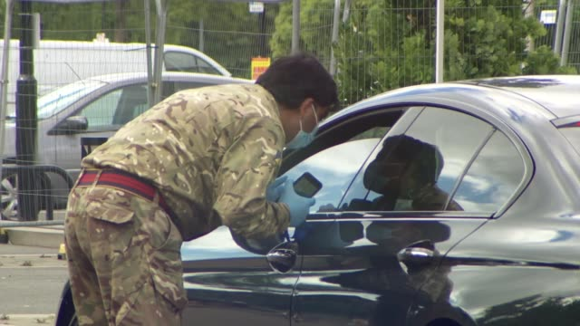lockdown restrictions could continue in leicester after covid19 cases surge england leicester ext dr mayur lakhani set up shots with reporter /... - apron stock videos & royalty-free footage