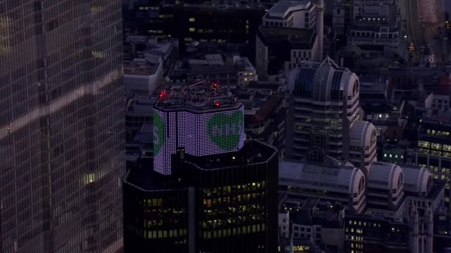london aerials during lockdown england london shots of city of london with 'nhs' message on natwest tower / canary wharf and canada square - dusk stock videos & royalty-free footage