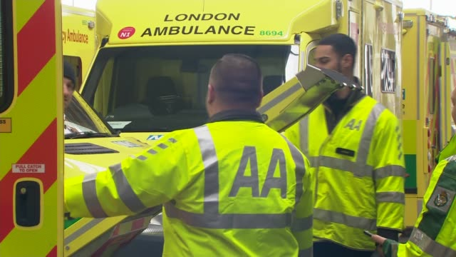 london ambulance service refitting over 100 disused vehicles to augment fleet; england: london: int rear view ambulance crew member lowering ramp at... - lowering stock videos & royalty-free footage