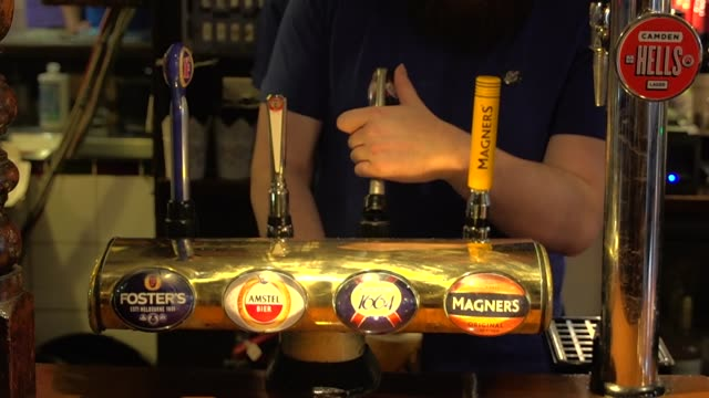 london bars and restaurants on second day of reopening; england: london: croydon: ext gvs the oval tavern pub / chalkboard sign outside pub re social... - croydon england stock videos & royalty-free footage