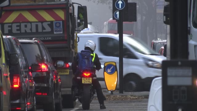 london roads busy as second lockdown begins; england: london: ext / fog / mist gv traffic jam on road into london rear view motorcyclist waiting at... - itv london lunchtime news stock videos & royalty-free footage