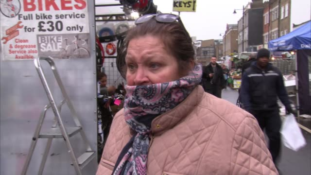 london tube services reduced as prospect of complete lock down looms; england: london: islington: chapel street market: ext customer and trader at... - itv london tonight stock-videos und b-roll-filmmaterial