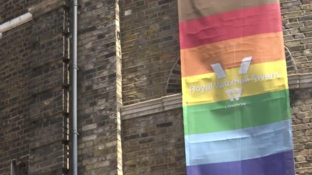 london's lgbt venues struggling under lockdown; england: london: vauxhall: int cleaned pint glasses at bar ext gv royal vauxhall tavern rainbow... - ベルベット点の映像素材/bロール