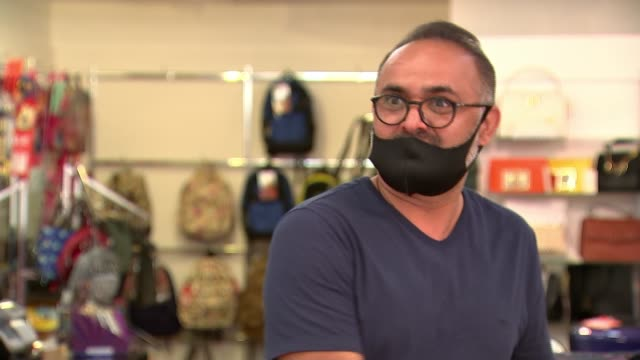 mandatory wearing of face masks in shops comes into force in england; england: london: sutton: ext shoppers into and out of food shop wearing medical... - shopping stock videos & royalty-free footage