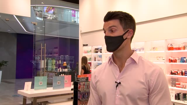 mandatory wearing of face masks in shops comes into force in england; england: int 'face mask required' sign in shop window various shots of shop... - cosmetics stock videos & royalty-free footage