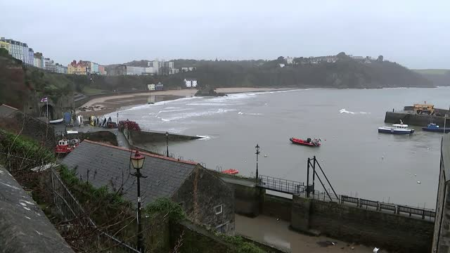 mark drakeford outlines possible lifting of lockdown restrictions for wales; wales: pembrokeshire: tenby: ext / wet general view of town man walking... - pembroke stock videos & royalty-free footage