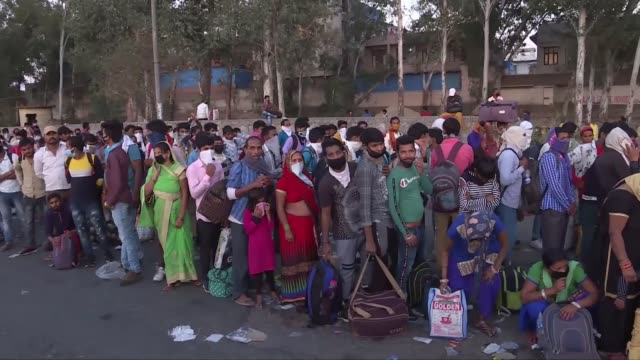mass migration of workers in india threatens coronavirus lockdown efforts; india: ext large crowd of people queue on road crowds walking along main... - india stock videos & royalty-free footage