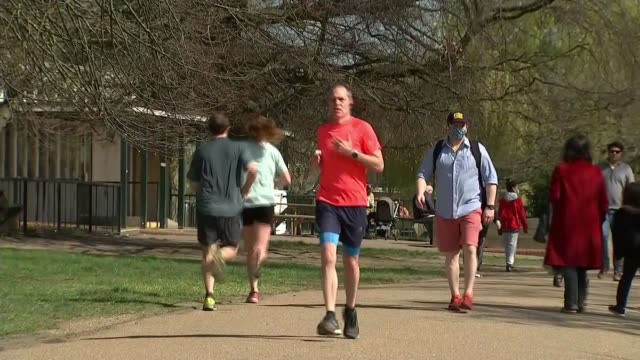 matt hancock says following social distancing rules is 'mission critical' england london ext woman exercising in park various shots of people jogging... - jogging stock videos & royalty-free footage
