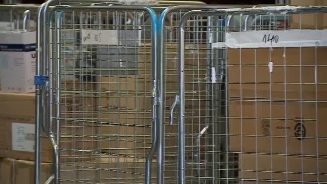 matt hancock visits london ambulance depot; england: london: lewisham: deptford ambulance station: int/ext gvs depot/warehouse with boxes of personal... - protective workwear stock videos & royalty-free footage