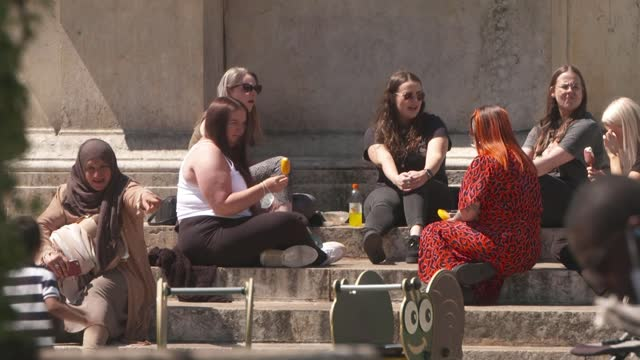 measure to combat spread of delta variant to cover all of greater manchester and lancashire; england: manchester: ext people sat in the sunshine in... - sunlight stock videos & royalty-free footage