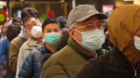 vídeos y material grabado en eventos de stock de coronavirus measures are taking place.many people in china have been trying to get to hong kong, while they still can.but authorities there - still... - reportaje imágenes