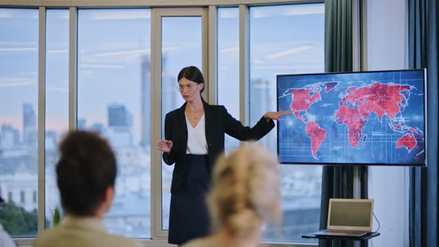 coronavirus medicine symposium. female doctor presenting world map of disease outbreaks - seminar stock videos & royalty-free footage