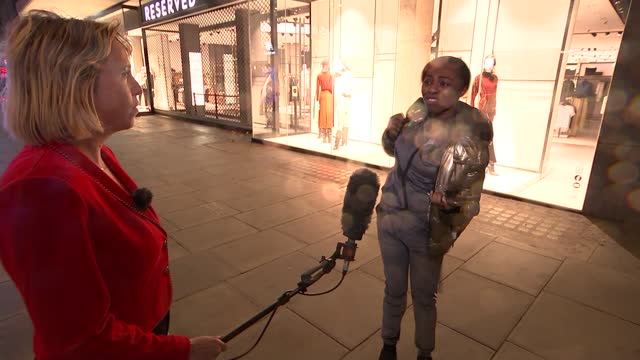 ministers consider plans for uk's coronavirus christmas; england: london: ext / night reporter to camera vox pops christmas lights in oxford street. - government minister stock videos & royalty-free footage