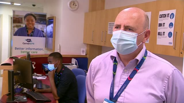 new 90minute tests to be rolled out next week england london chelsea and westminster hospital int dr gary davies interview sot - itv news at ten stock videos & royalty-free footage