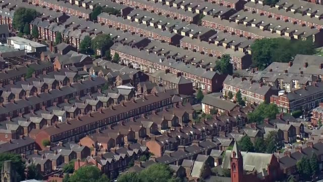 new lockdown restrictions imposed on northern england; england: ext air view / aerial rooftops of terraced houses and street in unidentified north... - town stock videos & royalty-free footage