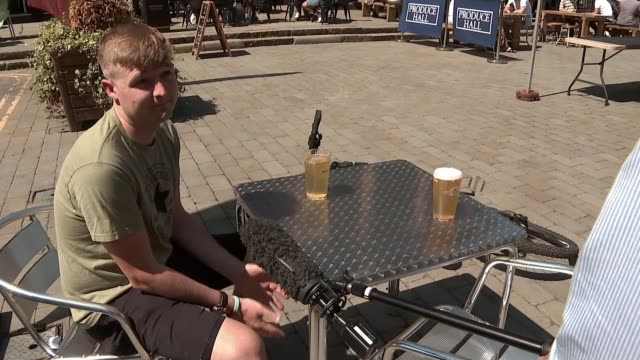 new lockdown restrictions imposed on northern england england greater manchester ext various of people seated drinking in groups at pub bar outdoor... - itv news at ten stock videos & royalty-free footage