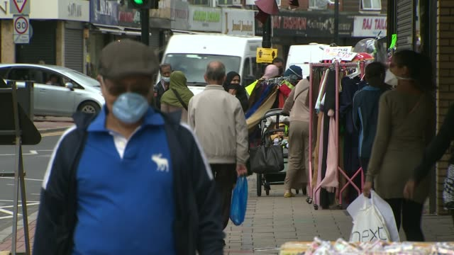 newham residents help with testing nhs test & trace app; england: london: newham: ext shoppers on busy high street - wearing medical faces masks - contact tracing stock videos & royalty-free footage