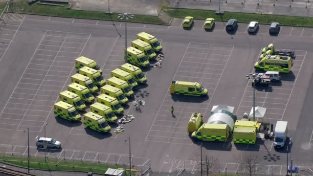 nhs confirms first death of health worker as death toll reaches 1228 england london canning town custom house excel centre ambulances parked in car... - ambulance stock videos & royalty-free footage