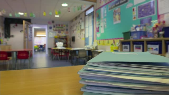 nhs front line staff complain of lack of protective equipment and testing england int gvs stationary in classroom in school - school building stock videos & royalty-free footage
