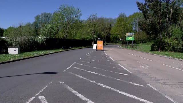 nhs testing site at chessington views england london kingstonuponthames chessington ext entrance road with sign saying that people attending must... - tourist resort stock videos & royalty-free footage