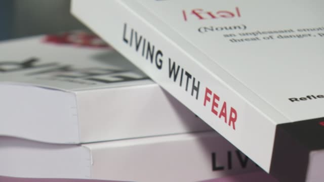 nhs workers write book about their experiences during pandemic england int estelle kabia interview sot 'living with fear' on spine of book - itv evening news stock videos & royalty-free footage