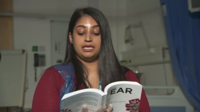 nhs workers write book about their experiences during pandemic england int estelle kabia reading from book sot ikra majid reading from book sot - itv evening news stock videos & royalty-free footage
