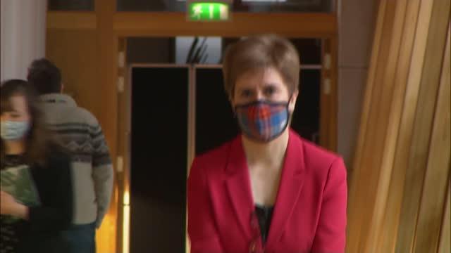 nicola sturgeon apologises for removing mask when talking in pub; scotland: edinburgh: scottish parliament; int nicola sturgeon msp and others along - nicola sturgeon stock videos & royalty-free footage