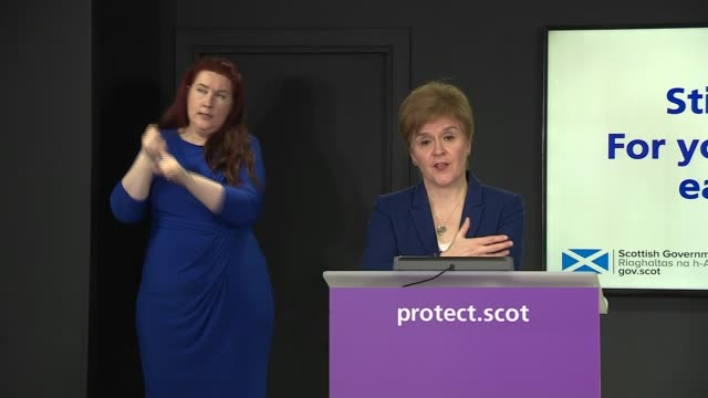 nicola sturgeon extends lockdown restrictions in scotland; scotland: edinburgh: int nicola sturgeon msp press conference sot - we are making case to... - arms raised stock videos & royalty-free footage