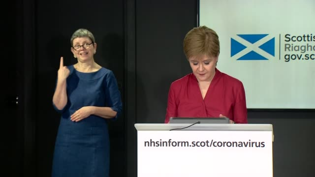 nicola sturgeon press conference may 1st; scotland: edinburgh: st andrew's house: int nicola sturgeon msp arriving into press conference / statement... - number 9 video stock e b–roll