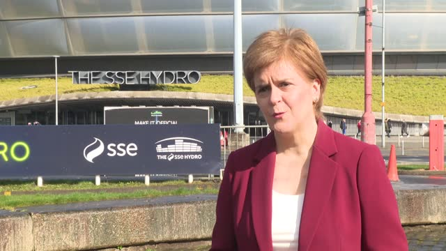 nicola sturgeon visits sse hydro vaccination centre; scotland: glasgow: sse hydro centre: ext various of nicola sturgeon msp talking to children and... - giving stock videos & royalty-free footage