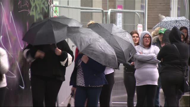 non-essential shops re-open in scotland / two household 'bubbles' can join together in wales; scotland: ext peopled queued around block to shop at... - aberdeen schottland stock-videos und b-roll-filmmaterial