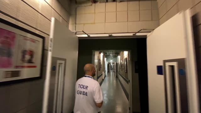 arena to welcome people back for backstage and arena tours; england: london: greenwich: o2 arena: int point of view shot following tour guide opening... - backstage stock videos & royalty-free footage