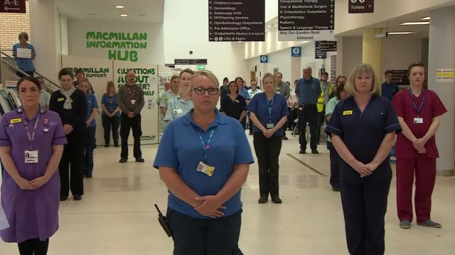 one minute's silence for keyworker deaths england norfolk kings lynn various shots of medical staff/doctors/nurses families and others observing... - death stock videos & royalty-free footage