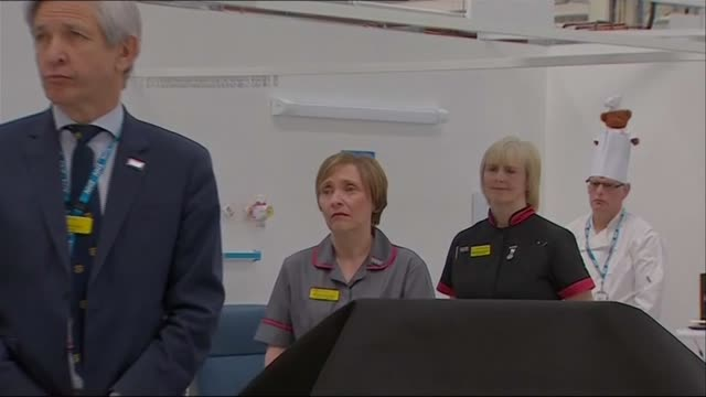 opening of nhs nightingale north east; england: tyne and wear: sunderland: int simon stevens message via video link shown on screen sot dame jackie... - nightingale stock videos & royalty-free footage