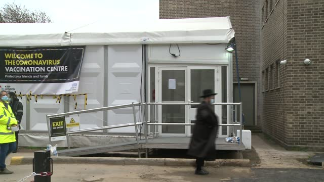 orthodox jews at vaccination centre; england: london: stamford hill: int gvs vaccination centre with staff in bays, box of gloves, tray of syringes... - bay of water stock videos & royalty-free footage
