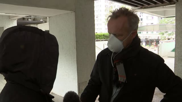 first death in territory as fear of virus spreads china hong kong ext block of flats where man who has died after contracting the coronavirus lived... - contracting stock videos & royalty-free footage