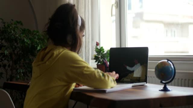 coronavirus outbreak. lockdown and school closures. schoolgirl watching online education class - mental health stock videos & royalty-free footage