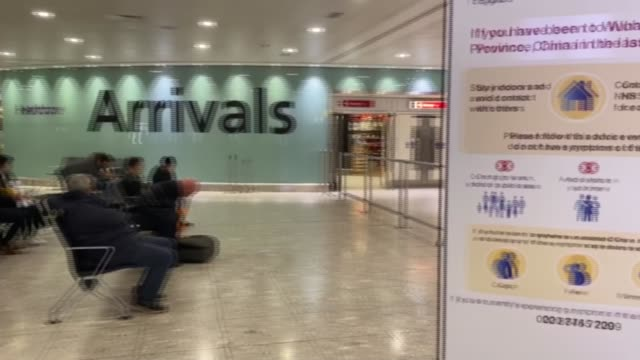 third coronavirus case identified in the uk england london heathrow airport int people waiting in airport pan warning sign for travellers who have... - airport stock videos & royalty-free footage