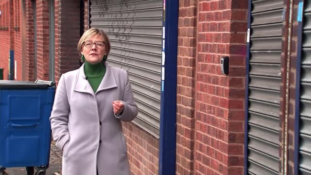 over 70 people fined after police raid makeshift nightclub; england: birmingham: buckingham street: ext low angle view of shuttered buildings and... - crime stock videos & royalty-free footage