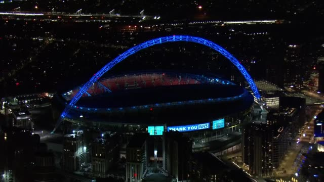 overnight aerials over deserted london including transport hubs; england: london: ext / night air view shots of london skyline / wembley stadium... - wembley stadium stock videos & royalty-free footage