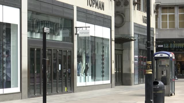 oxford street shops preparing to safely open; england: london: oxford street: ext bus along empty oxford street past john lewis department store few... - shop stock videos & royalty-free footage