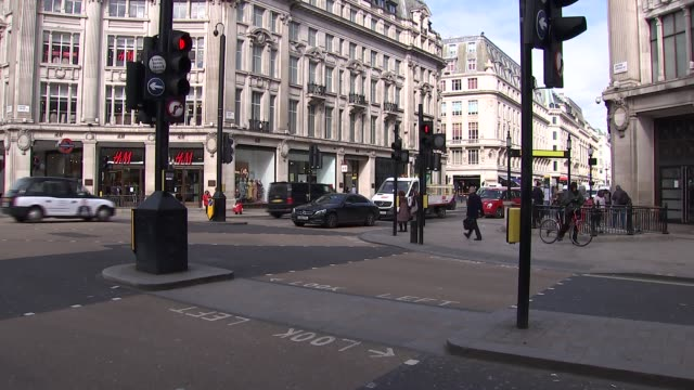 oxford streets and soho gvs; england: london: oxford street: ext general views of oxford circus junction and oxford street with people along buses... - red stock videos & royalty-free footage