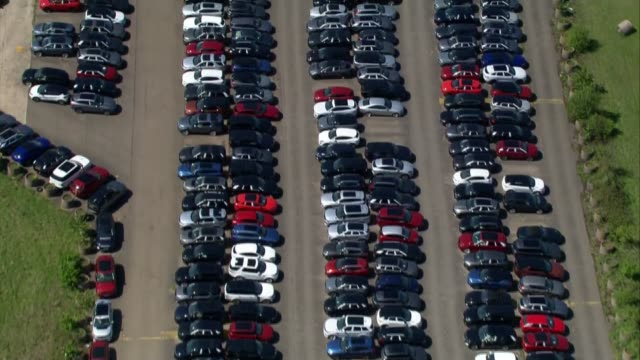 oxfordshire aerials; england: oxfordshire: ext air views raf upper heyford airfield and hundreds of cars parked in car park pull out disused aircraft... - airplane hangar stock videos & royalty-free footage