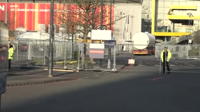 oxygen tanks delivered to nhs nightingale; england: london: docklands: excel centre: nhs nightingale: ext trucks carrying large oxygen tanks pull in... - london docklands stock videos & royalty-free footage