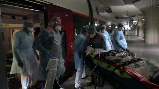 a coronavirus patient being treated on a train in paris - underground train stock videos & royalty-free footage