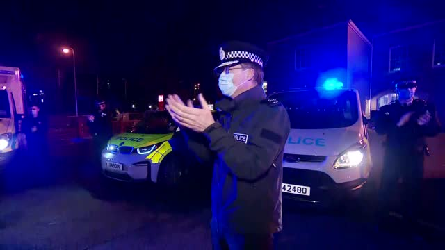 people across uk join in clap for captain sir tom moore; channel islands: ext / night gvs police applauding with sirens blaring - channel islands england stock videos & royalty-free footage