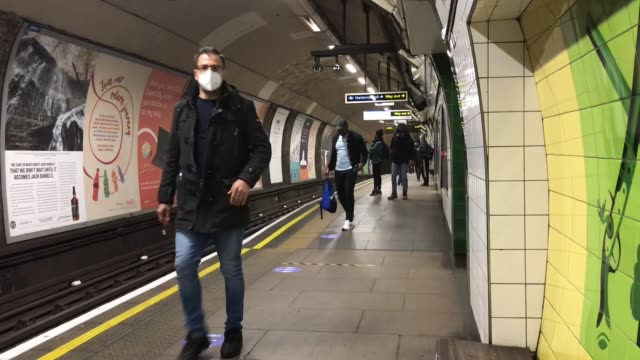 people begin to return to work: finsbury; england: london: finsbury: ext gv entrance to finsbury park station int track along from lift through... - railway track stock videos & royalty-free footage